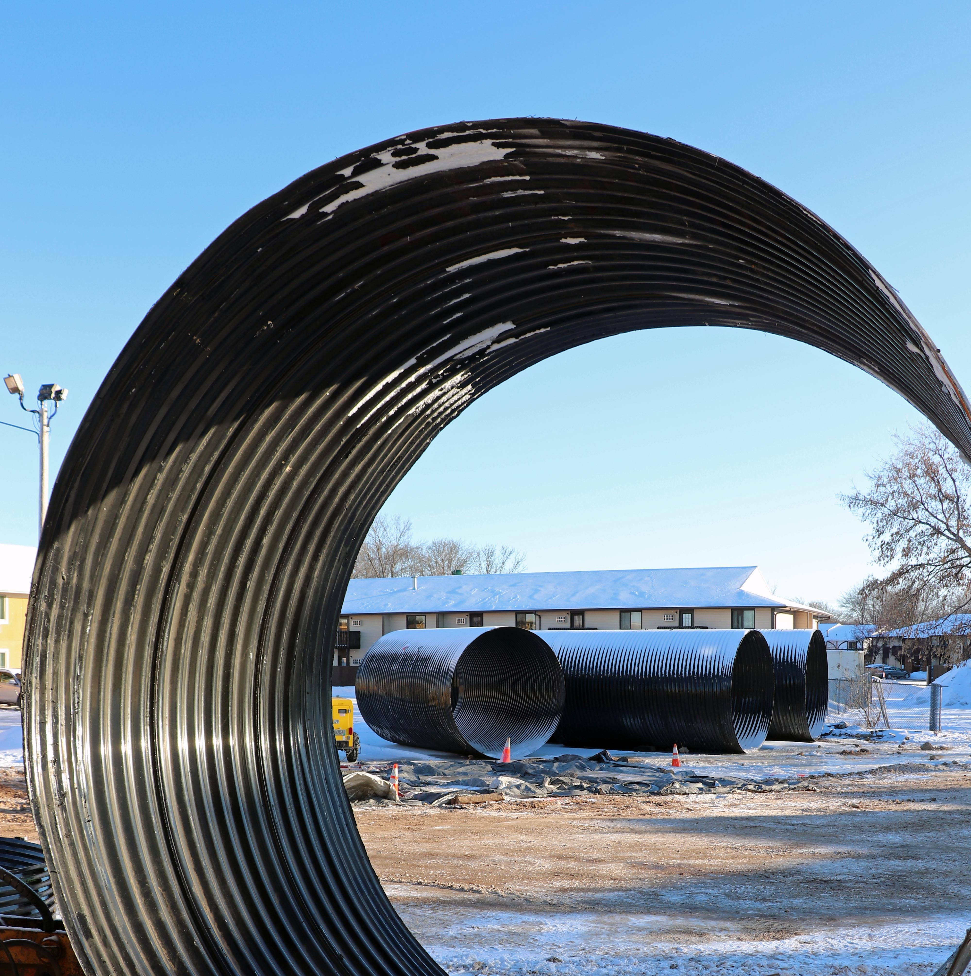 Pipes along College Avenue? They're for an underground, navigable stream in Grand Chute