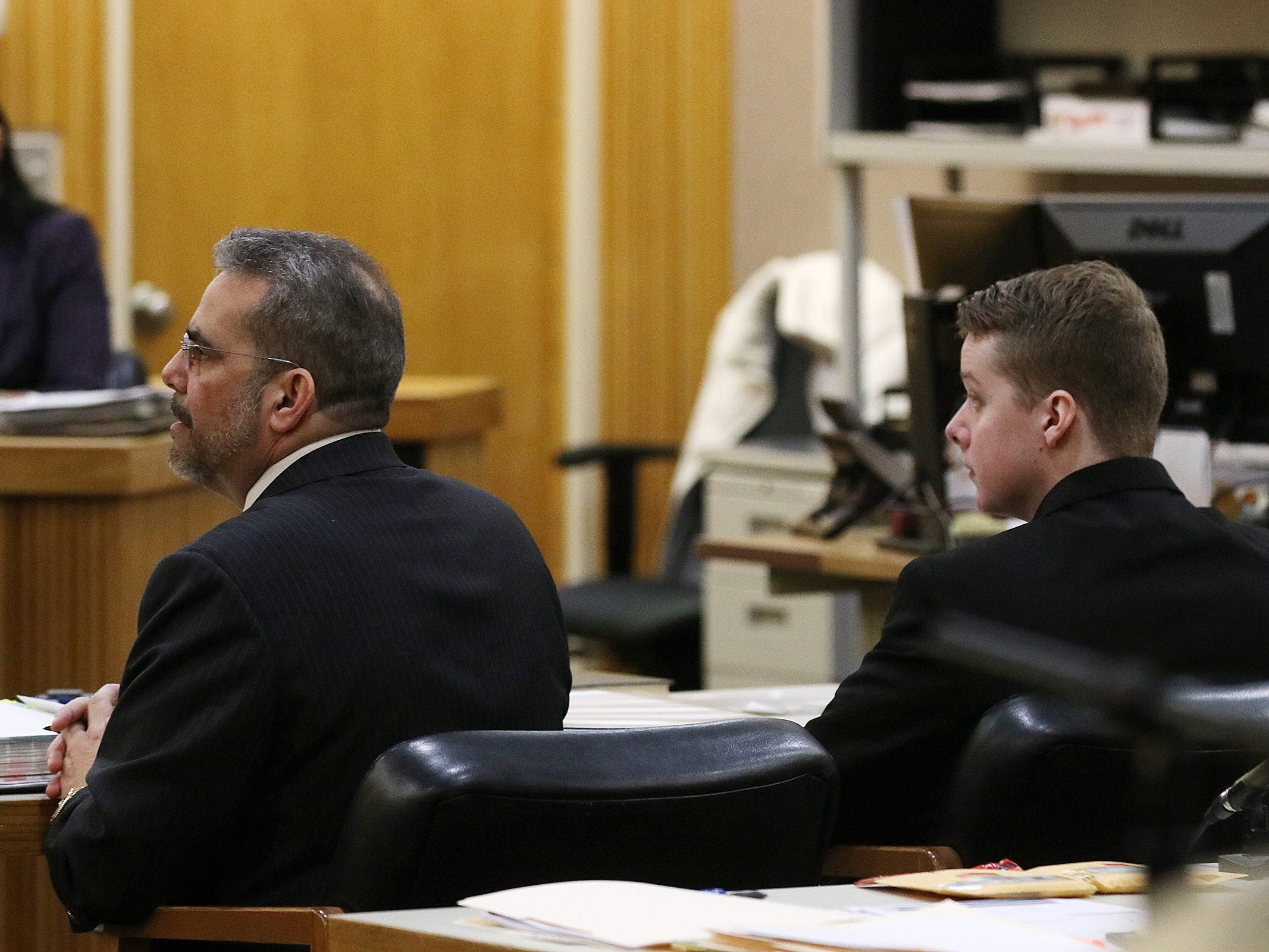 Defense attorney Carlos Diaz-Cobo and Liam McAtasney, who is charged with the murder of former high school classmate, Sarah Stern, look over at the jury during trial before Superior Court Judge Richard W. English at the Monmouth County Courthouse in Freehold, NJ Wednesday, February 13, 2019.  The jury was sent home for the day after Carlos Diaz-Cobo, the defense attorney, made a motion for a mistrial over a post made on a juror's Facebook page.
