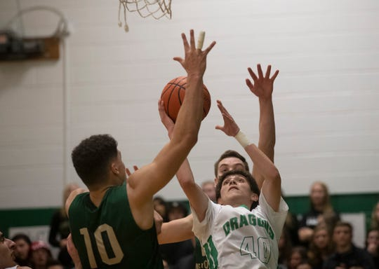 Brick's Brandon Bautista goes up with a shot  against Memorial's Matt Bernstein during first half action. Brick Memorial Boys Basketball vs Brick High School in Brick NJ on February 13, 2019.