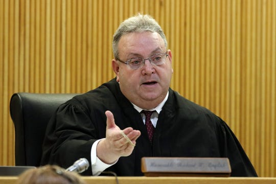 Superior Court Judge Richard W. English listens to a motion for mistrial by defense attorney Carlos Diaz-Cobo, during the trial of Liam McAtasney, who is charged with the murder of former high school classmate, Sarah Stern, at the Monmouth County Courthouse in Freehold, NJ Wednesday, February 13, 2019. The jury was sent home for the day after Carlos Diaz-Cobo, the defense attorney, made a motion for a mistrial over a post made on a juror's Facebook page.