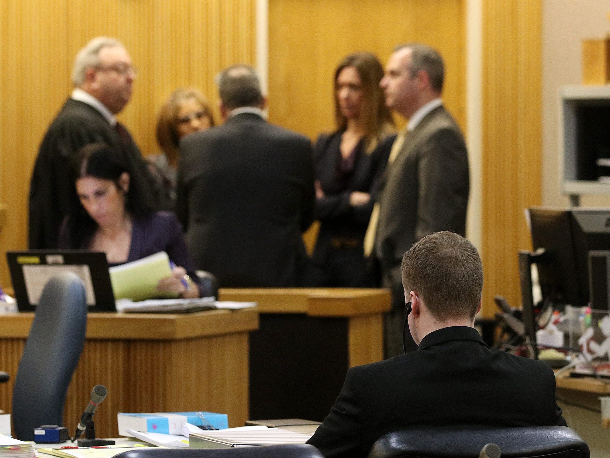 Liam McAtasney, who is charged with the murder of former high school classmate, Sarah Stern, listens during a sidebar during trial before Superior Court Judge Richard W. English at the Monmouth County Courthouse in Freehold, NJ Wednesday, February 13, 2019.  The jury was sent home for the day after Carlos Diaz-Cobo, the defense attorney, made a motion for a mistrial over a post made on a juror's Facebook page.