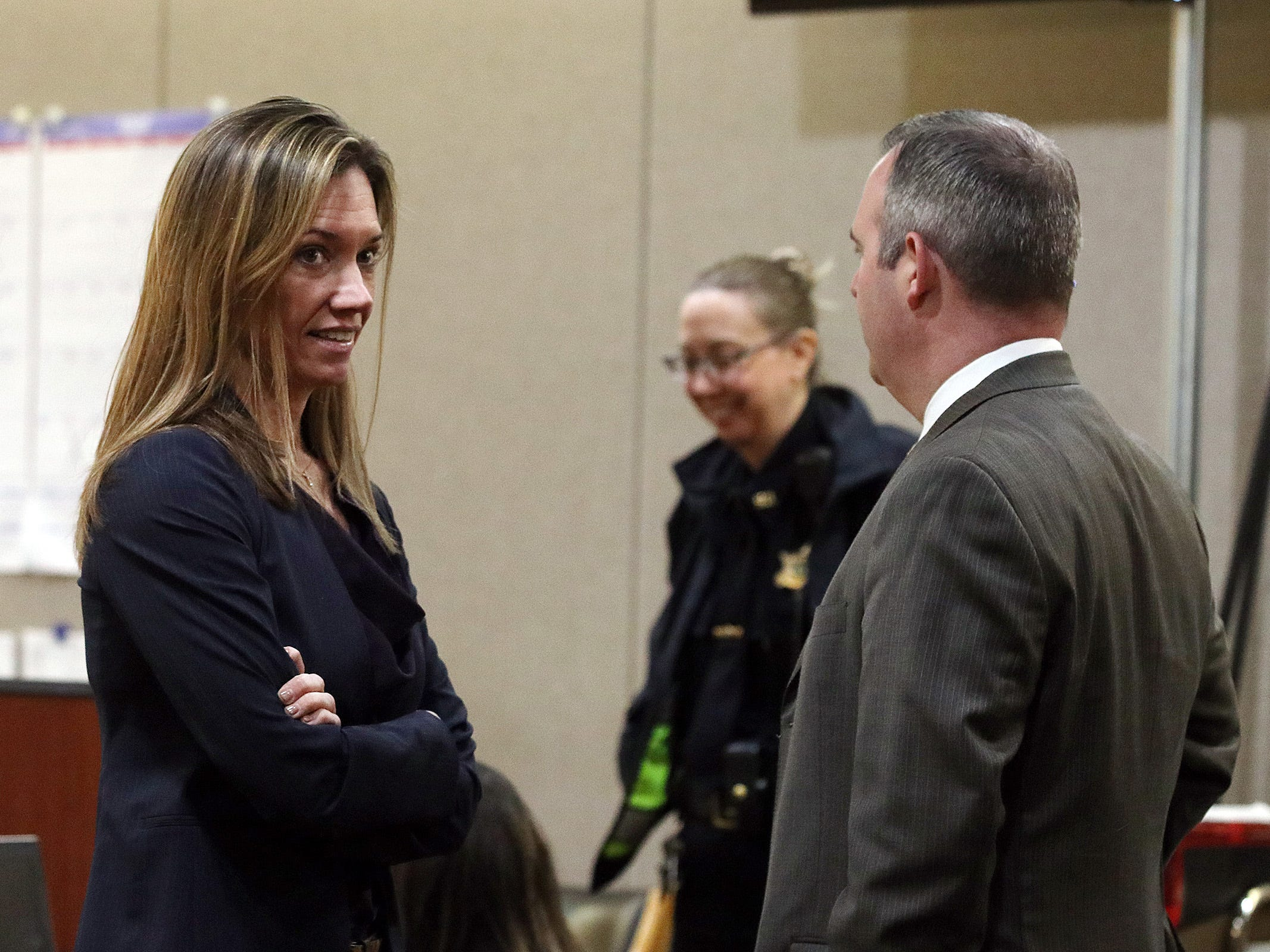 Monmouth County assistant prosecutors Meghan Doyle and Christopher Decker talk during a short recess in the trial of Liam McAtasney, who is charged with the murder of former high school classmate, Sarah Stern, before Superior Court Judge Richard W. English at the Monmouth County Courthouse in Freehold, NJ Wednesday, February 13, 2019. The jury was sent home for the day after Carlos Diaz-Cobo, the defense attorney, made a motion for a mistrial over a post made on a juror's Facebook page.