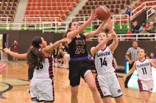 Wylie senior guard Mary Lovelace (24) goes up for a shot between two Plainview defenders in the Region I-5A bi-district playoff at The Coliseum in Snyder on Tuesday, Feb. 12, 2019. Wylie's season ended with a 48-42 overtime loss.