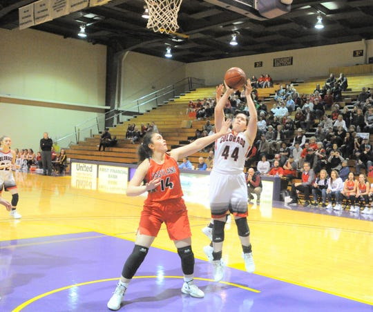 Colorado City senior Haley Bridges (44) puts up a shot in the lane as Eastland's McKall Morton defends.