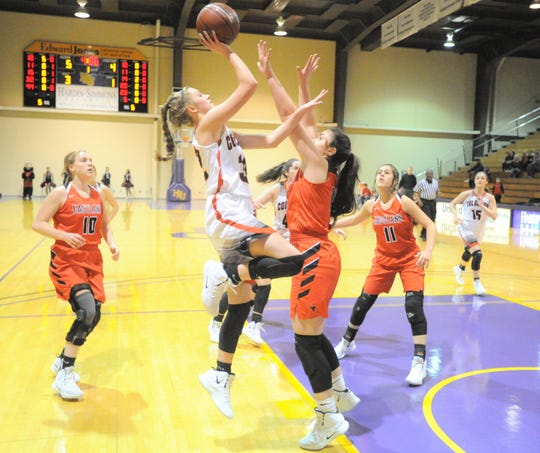 Colorado City's Taylor Smith, center, rises up for a shot over Eastland's McKall Morton on Tuesday, Feb. 12, 2019, at the Mabee Athletic Complex.