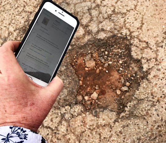 Potholes, such as this one near Carver Drive and East South Seventh Street on Wednesday, and other problems can be reported to the City of Abilene on the app SeeClickFix.