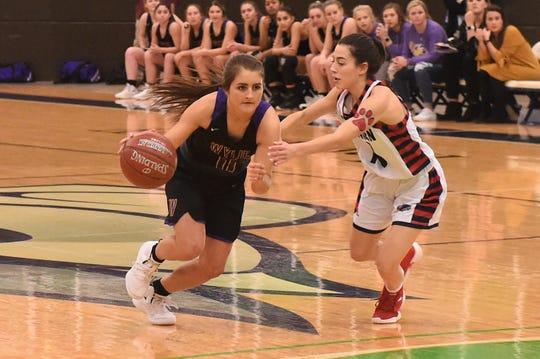 Wylie senior Madi Latham (11) drives past a Plainview defender in the Region I-5A bi-district playoff at The Coliseum in Snyder on Tuesday, Feb. 12, 2019. Wylie's season ended with a 48-42 overtime loss.
