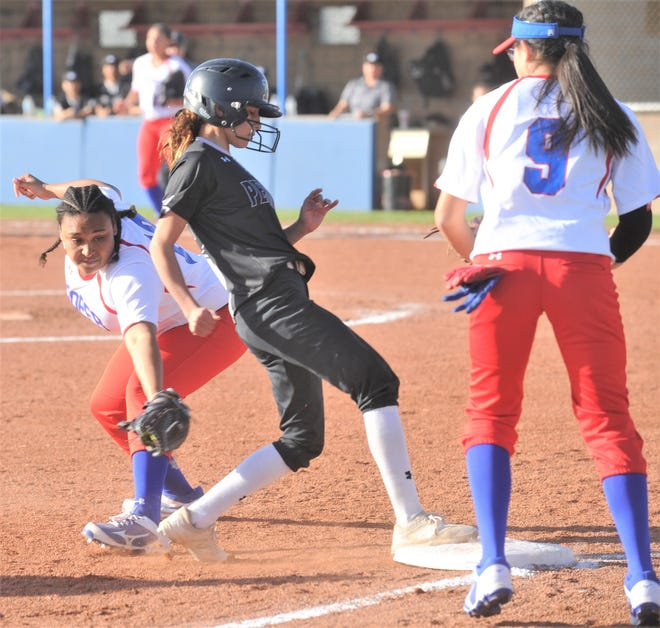 Odessa Permian's Karisma Aguilar, center, steps safely onto third base as Cooper third baseman Jada Willis, right, lunges for the tag in the third inning. Permian scored four runs in the inning en route to a 10-0 victory in six innings on Tuesday, Feb. 12, 2019, at Cougar Diamond.