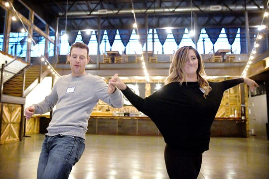 Jason Boyer, Chief Meteorologist at WLOS and his dance partner Meghan Lavender show off the progress of their dance number during a rehearsal for Dancing with the Local Stars, a fundraiser for the American Cancer Society, at Highland Brewing on Feb. 10, 2019.