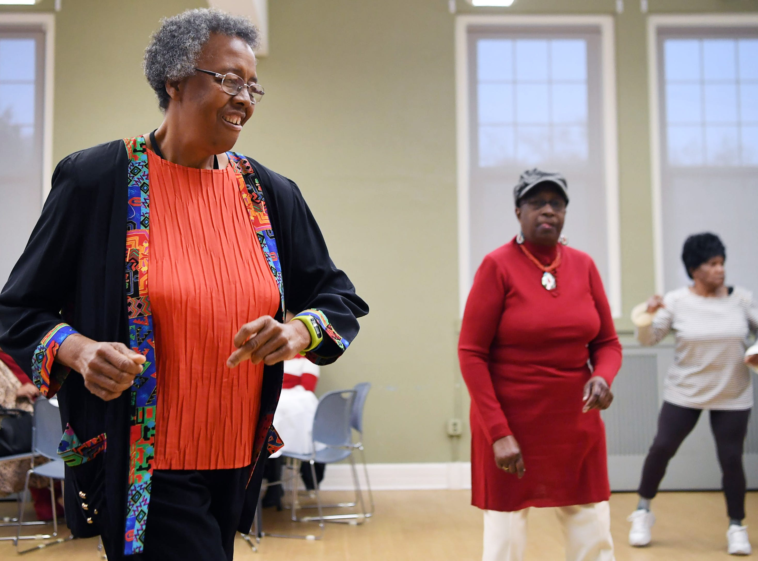 From left, Cynthia Byrd, Theresa Bowan and Effie Kelly dance during the District 9 senior club Valentine social at the Stephens-Lee Recreation Center in Asheville Feb. 12, 2019.