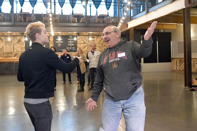 WLOS sportscaster Stan Pamfilis, and emcee for Dancing with the Local Stars, works on his entrance with Travis Stancil during a rehearsal for the show, which benefits the American Cancer Society, at Highland Brewing on Feb. 10, 2019. Asheville Mayor Esther Manheimer will also be an emcee of the show.