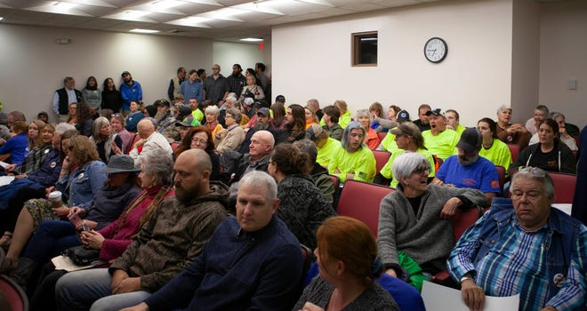 Members of the public gather at the A-B Tech Madison campus Feb. 12 to attend the Madison County Board of Commissioners meeting. 30 people use the meeting's public comment section to discuss the effects of a propsed asphalt plant just outside of downtown Marshall.