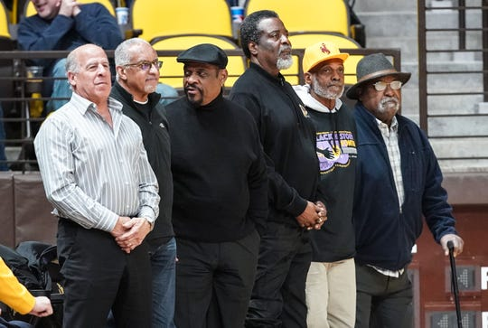 Six former Black 14 players (Tony Gibson, Ivie Moore, Guillermo Hysaw, John Griffin, Tony McGee and Mel Hamilton - not in that order) return to Wyoming campus for rare appearance at game against the Colorado State.