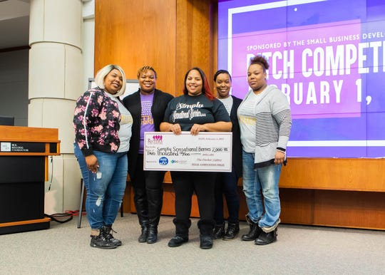 Markeeta Haddley (center) was the first-place winner at the Sisters in Business pitch competition held on Feb. 1, 2019.
