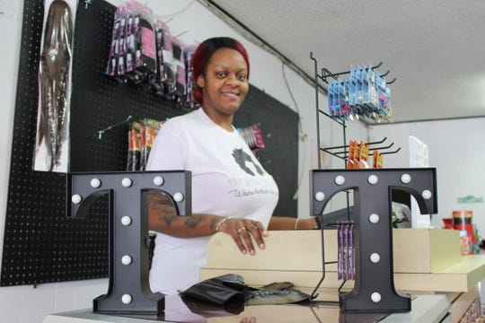 Te'Sha Showers owns a beauty supply store on Austin Avenue in Albion. She hopes to one day move her business downtown.