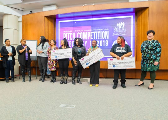 Shannon Patrick (holding check on left), Elishae Johnson (holding check center) and Markeeta Haddley (holding check right) were the winners at the Sisters in Business pitch competition held on Feb. 1, 2019.