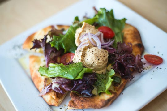 Hummus and roasted vegetable flat bread pizzetta with heritage greens salad from The Shop, pictured in 2016.