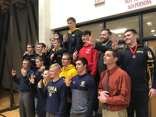 Tioga wrestlers celebrate after winning their straight Section 4 Division II title Saturday at Windsor.