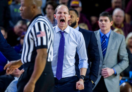 Washington coach Mike Hopkins shouts to his team during the second half of an NCAA college basketball game against Arizona State on Saturday, Feb. 9, 2019, in Tempe, Ariz. Arizona State won 75-63.