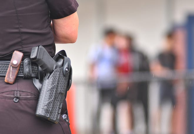 A Melbourne police school resource officer on duty at a Melbourne school on Wednesday.