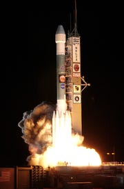 "The second Mars Exploration Rover, Opportunity, lifted off  from Cape Canaveral Air Force Station on a Delta II ""heavy"" rocket at 11:18 p.m. July 7, 2003."