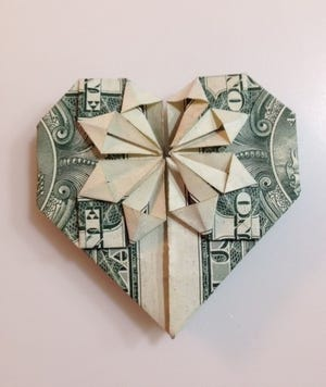 Carolyn Richardson folded this dollar bill into an Origami heart. It was given to Mary Lee inside an origami gift box last Valentine's Day, along with chocolates.