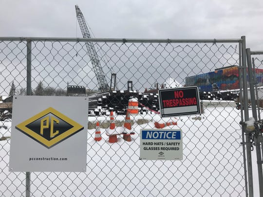 PC Construction, general contractor for CityPlace Burlington, is recalculating costs on the project.