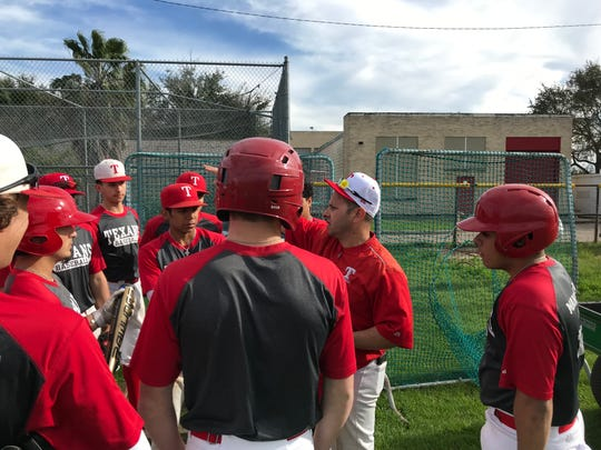 Ray head baseball coach Orlando Ruiz talks to his team prior to a practice on Feb. 12, 2019 at Ray High School.