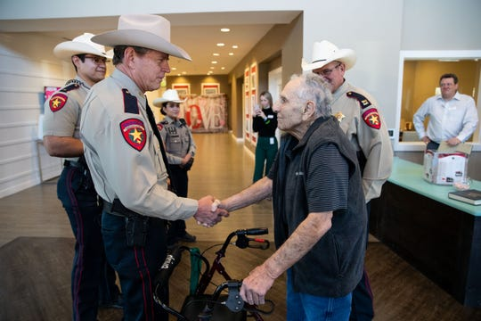 Nueces County Sheriff J.C. Hooper shakes hands with 93-year-old Edward 'Eddie' Ogdee before making him an honorary deputy at the Elan Corpus Christi Assisted Living & Memory Care Community on Wednesday, Feb. 13, 2019.