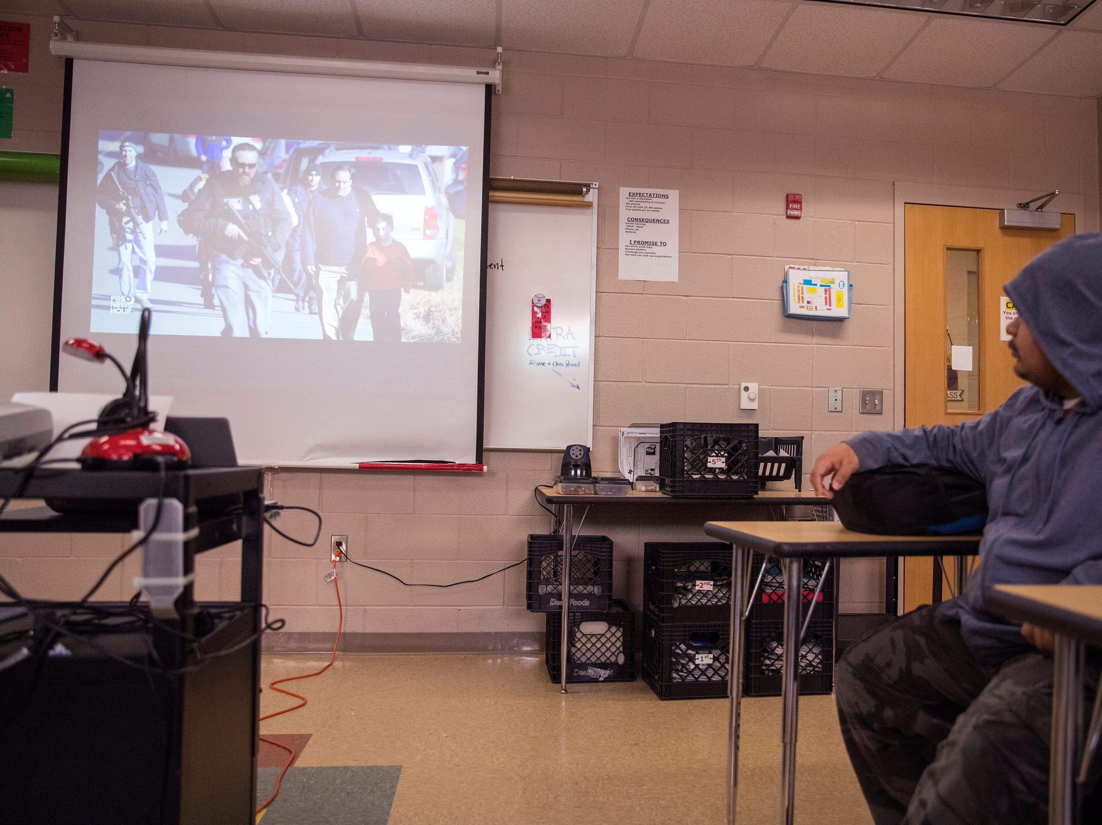 """Xzavier Villarreal, 17, watches a video about an app created to help prevent school shootings following the Parkland school shooting during """"bear time"""" at West Oso High School on Wednesday, February 13, 2019. The homeroom period is used as a safe space during which teachers are expected to develop a home away from home culture where they can pick up on any warning signs that students may be having suicidal thoughts so they can be referred to counselors."""
