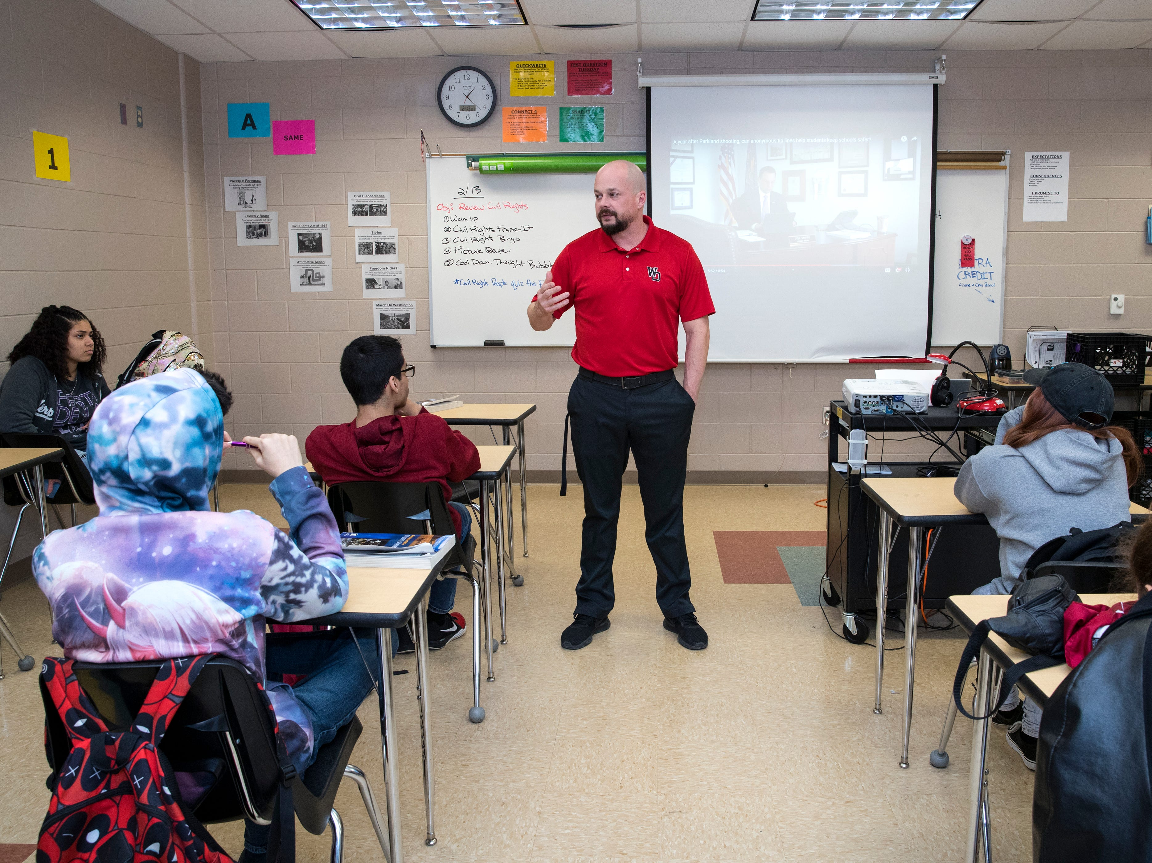 """History teacher Chandler Davis talks with his homeroom class about a video they watched about an app created to help prevent school shootings following the Parkland school shooting during """"bear time"""" at West Oso High School on Wednesday, February 13, 2019. The homeroom period is used as a safe space during which teachers are expected to develop a home away from home culture where they can pick up on any warning signs that students may be having suicidal thoughts so they can be referred to counselors."""