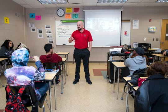 "History teacher Chandler Davis talks with his homeroom class about a video they watched about an app created to help prevent school shootings following the Parkland school shooting during ""bear time"" at West Oso High School on Wednesday, February 13, 2019. The homeroom period is used as a safe space during which teachers are expected to develop a home away from home culture where they can pick up on any warning signs that students may be having suicidal thoughts so they can be referred to counselors."