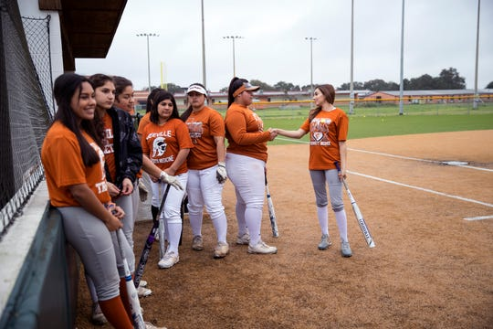 Beeville softball players wait their turn for batting practice on Monday, February 12, 2019. The Trojans have been a regional power for the last several seasons but lost a talented senior class.