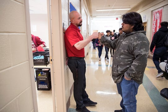 "History teacher Chandler Davis greets Tino Ramirez, 17, at the beginning of his homeroom period, which is also known as ""bear time,"" at West Oso High School on Wednesday, February 13, 2019. The homeroom period is used as a safe space during which teachers are expected to develop a home away from home culture where they can pick up on any warning signs that students may be having suicidal thoughts so they can be referred to counselors."