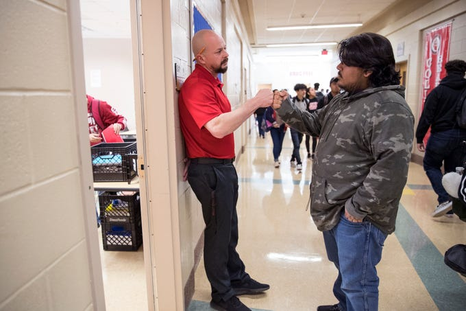 """History teacher Chandler Davis greets Tino Ramirez, 17, at the beginning of his homeroom period, which is also known as """"bear time,"""" at West Oso High School on Wednesday, February 13, 2019. The homeroom period is used as a safe space during which teachers are expected to develop a home away from home culture where they can pick up on any warning signs that students may be having suicidal thoughts so they can be referred to counselors."""