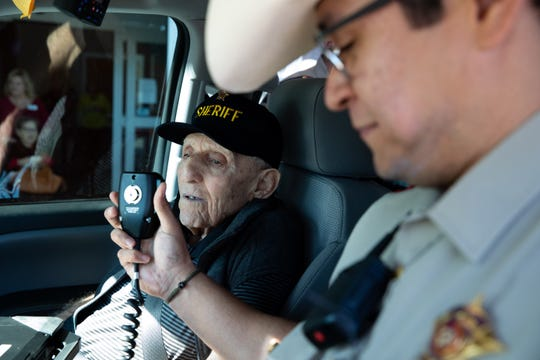 Ninety-three-year-old Edward 'Eddie' Ogdee sits in a police cruiser for a ride-along for his 'Miracle Moment' put on by the Elan Corpus Christi Assisted Living & Memory Care Community on Wednesday, Feb. 13, 2019. Ogdee served as the sheriff of Brooks County in the 1970s.