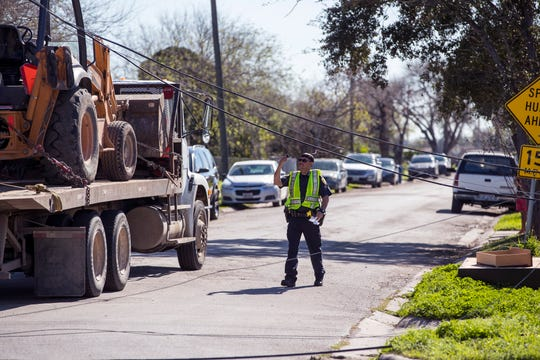 The Corpus Christi Police Department responded to the scene of an accident involving a truck driver at the corner of Sycamore Place and Greenwood Drive on Wednesday, February 13, 2019. The truck became entangled in utility lines and pulled down two poles, leaving several blocks around Greenwood Drive without power.