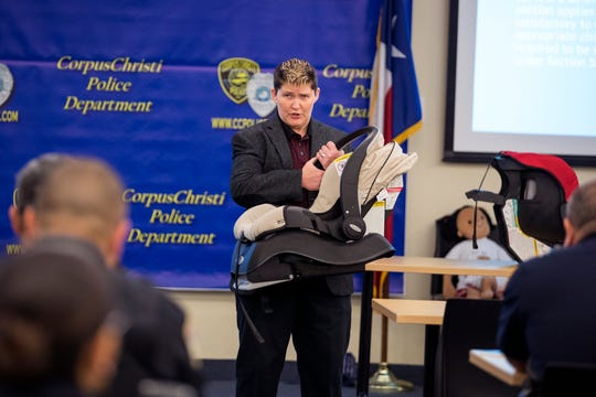 Lynda Walker with the Texas Municipal Police Association teaches a Child Occupant Restraint Enforcement class to Corpus Christi Police officers, Corpus Christi Independent School District Police officers and caregivers of young children at the Corpus Christi Police Department on February 7, 2019. The goal of the class is to create awareness of the importance of child passenger safety eduction and enforcement in preventing child deaths and injuries.