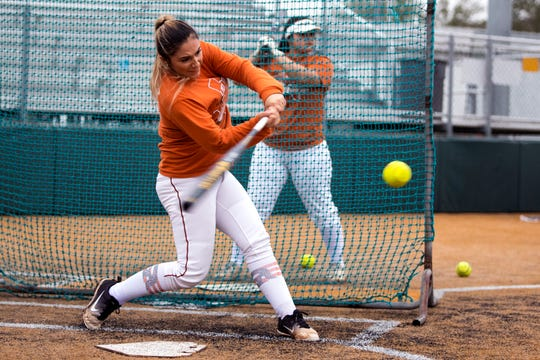 Beeville catcher Felixia Hinojosa gets in some batting practice on Monday, February 12, 2019. She and another player are tasked with keeping the Trojans successful after the team lost a talented senior class.