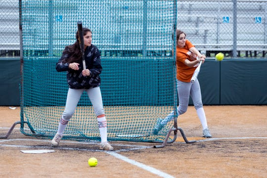 Beeville's Allie Estrada (left) and Haley Deal get in some batting practice on Monday, February 12, 2019. The Trojans have been a regional power for the last several seasons but lost a talented senior class.