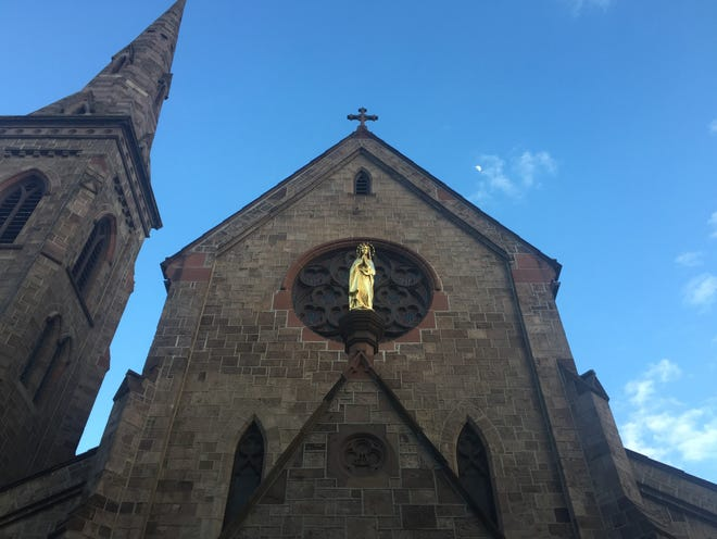 A spire rises above the Cathedral of the Immaculate Conception in Camden.