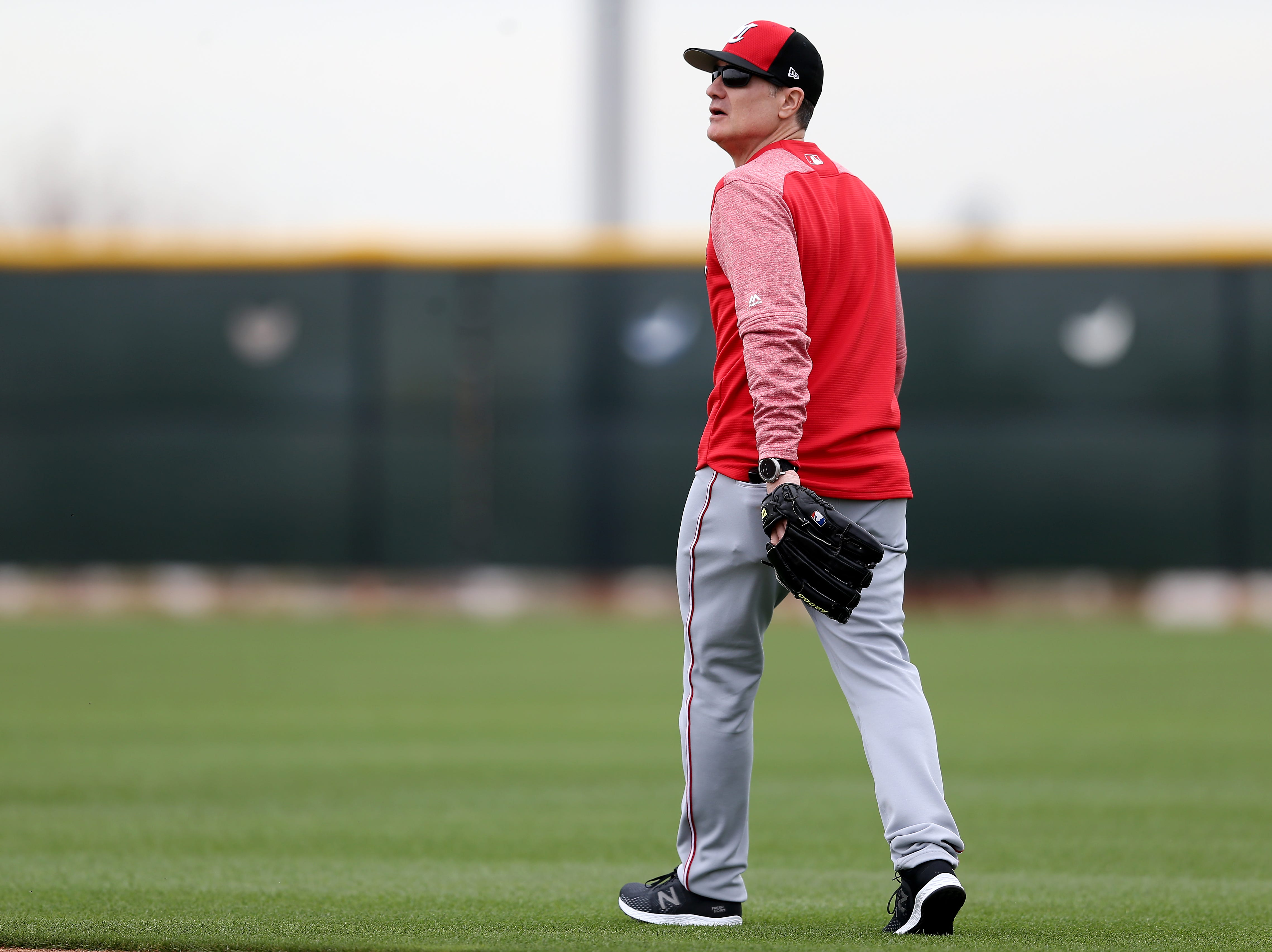 Cincinnati Reds manager David Bell (25) walks to the outfield during drills, Wednesday, Feb. 13, 2019, at the Cincinnati Reds spring training facility in Goodyear, Arizona.