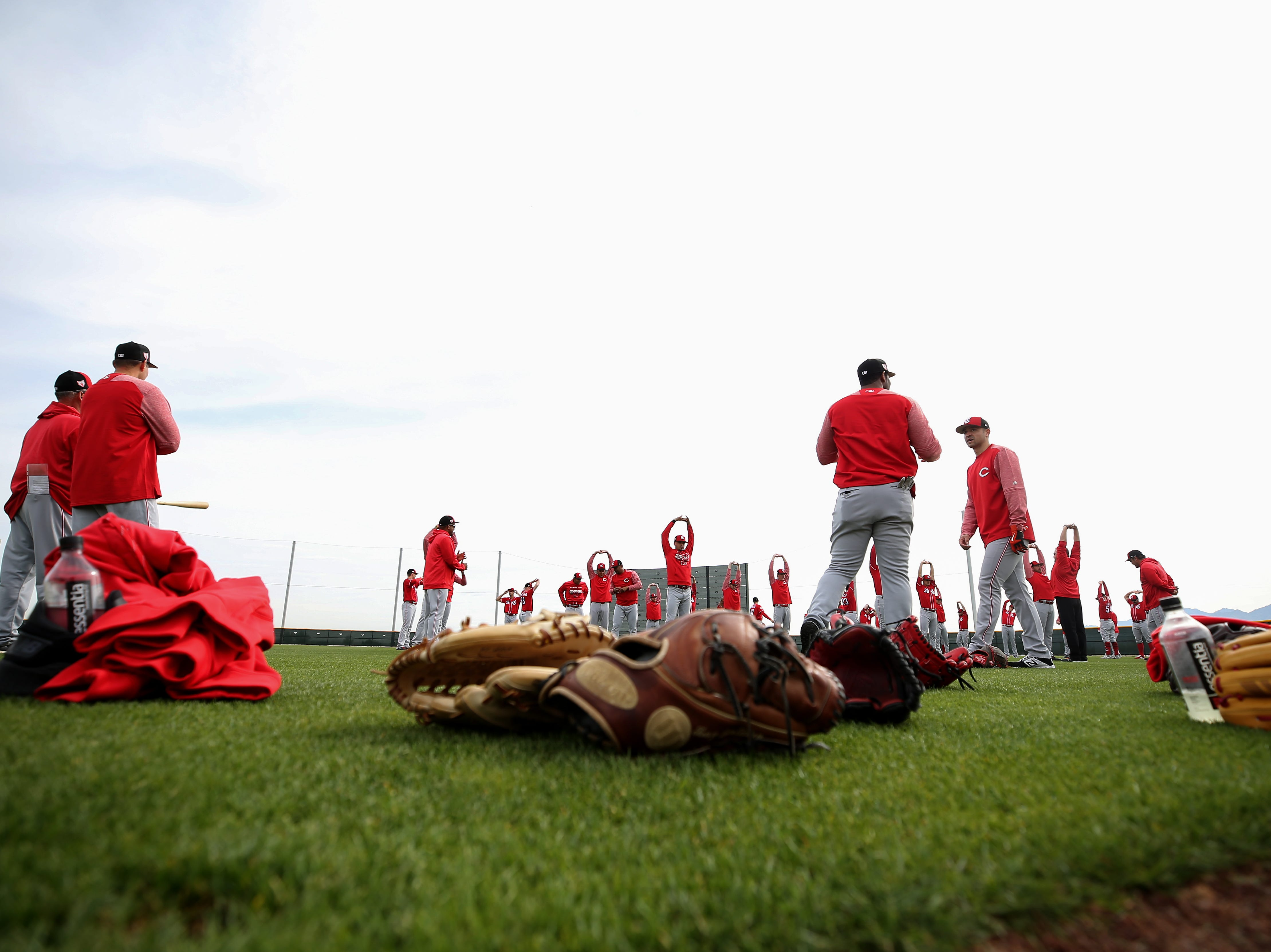 Cincinnati Reds pitchers stretch on the first day of formal workouts, Wednesday, Feb. 13, 2019, at the Cincinnati Reds spring training facility in Goodyear, Arizona.