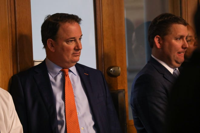 GM and President of FC Cincinnati, Jeff Berding, stands in the back of a city council meeting, deciding a vote regarding the building of a soccer stadium in the West End of Cincinnati.