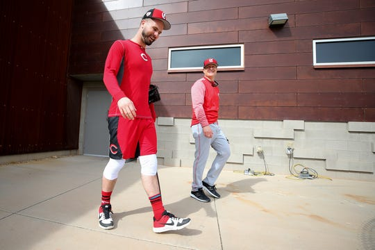 Cincinnati Reds outfielder Jesse Winker (33) and manager David Bell (25) out out of the clubhouse ahead of the first day of workouts, Wednesday, Feb. 13, 2019, at the Cincinnati Reds spring training facility in Goodyear, Arizona.