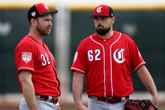 Cincinnati Reds relief pitcher Zach Duke (32), left, and Cincinnati Reds relief pitcher Jackson Stephens (62), right, talk, Wednesday, Feb. 13, 2019, at the Cincinnati Reds spring training facility in Goodyear, Arizona.