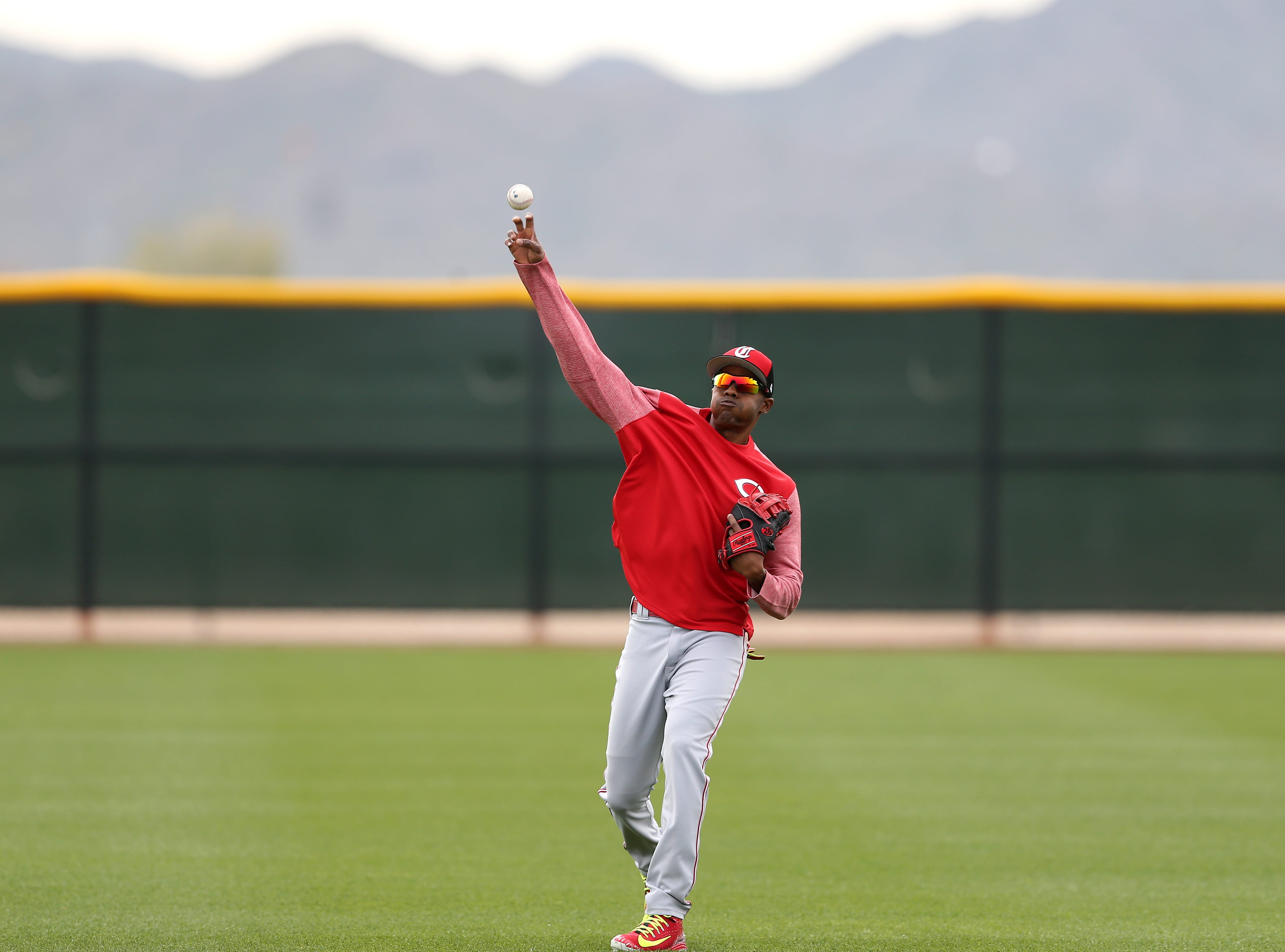 Cincinnati Reds relief pitcher Raisel Iglesias (26) long tosses, Wednesday, Feb. 13, 2019, at the Cincinnati Reds spring training facility in Goodyear, Arizona.