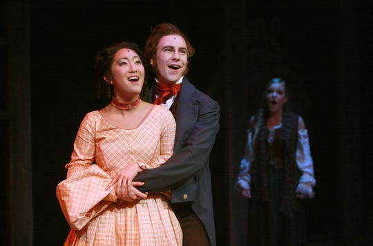 "Seen here in the College-Conservatory of Music's 2014 production of ""Les Misérables"" is Stephanie Jae Park, left, who is in ""Hamilton: An American Musical,"" which opens Feb. 19 at the Aronoff Center and runs through March 10. Seen with Park are Eric Geil and, in the background, is Lawson Young."