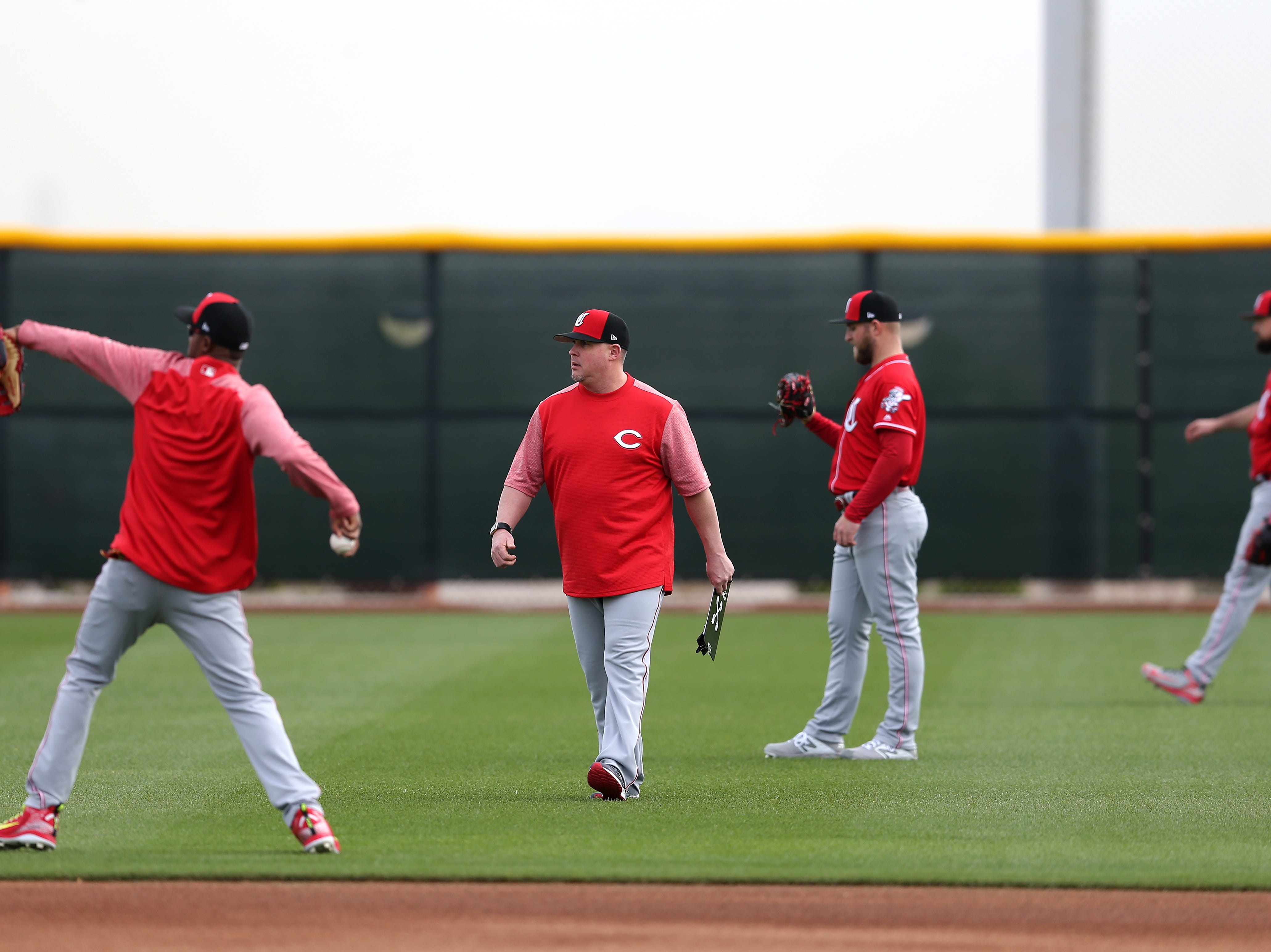 Cincinnati Reds pitching coach Derek Johnson observes as pitchers long toss, Wednesday, Feb. 13, 2019, at the Cincinnati Reds spring training facility in Goodyear, Arizona.