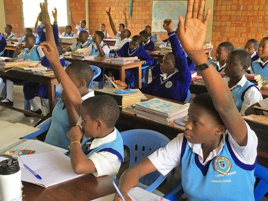 Students at Notre Dame Senior Secondary Academy in Buseesa, Uganda participate in mathematics class.